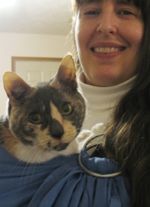 Photo -- Marcy wearing the kitty in the baby-sling.