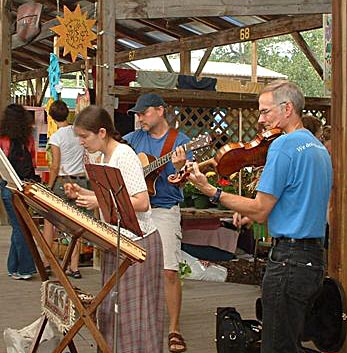 Photo — The Hanshaw Trio at the Ithaca Farmers Market; by Noella Prochaska.